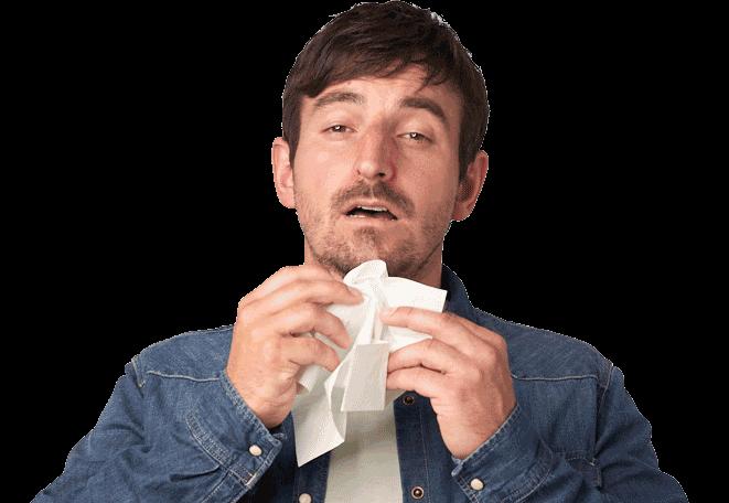 Abbildung Mann niest typische Schnupfensymptome